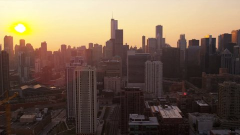 Aerial low level sunrise city view of Chicago skyline downtown financial district, Chicago, Illinois, USA