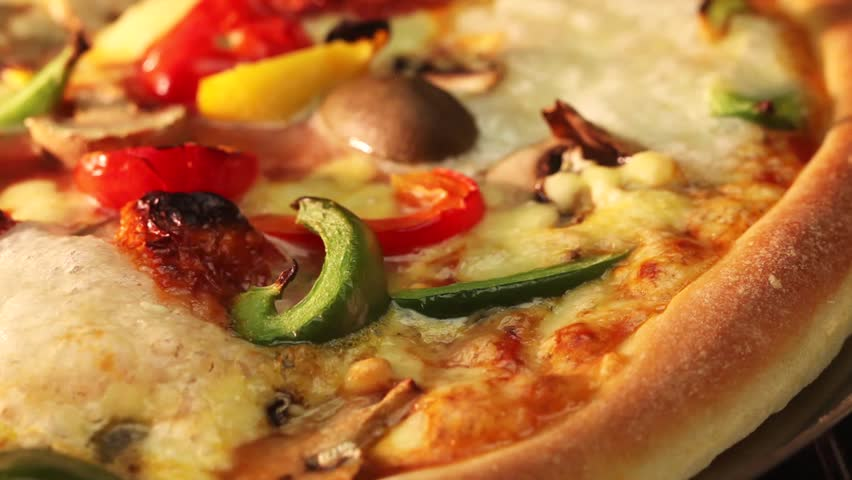 A vegetarian pizza in an oven (close-up)