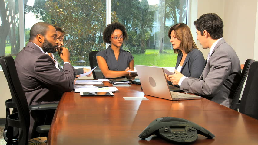 Young female African American team leader chairing boardroom meeting with successful multi ethnic business colleagues | Shutterstock HD Video #4285088
