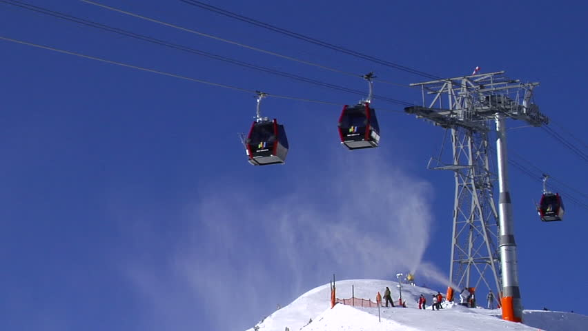 Cable-cars and snowmaking in a ski-resort in the European Alps