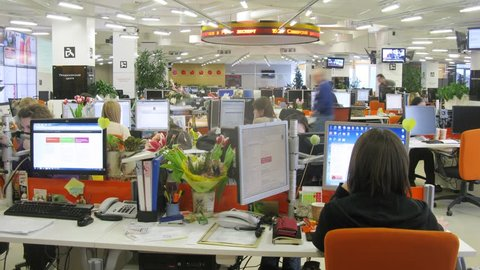 MOSCOW - MAR 05: (timelapse) Journalists at their desks working at RIA Novosti, on Mar 05, 2013 in Moscow, Russia.
