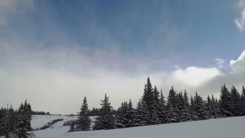 Long time lapse of clouds over Alaskan landscape