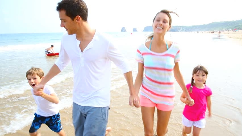 Happy Family Running On The Stock Footage Video 100 Royalty