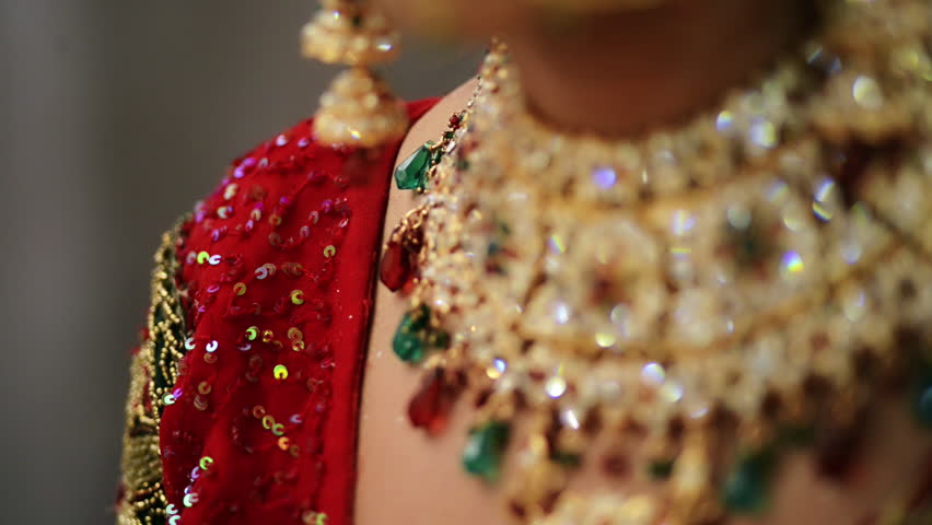 Tilt up shot of a Indian bride wearing jewelry