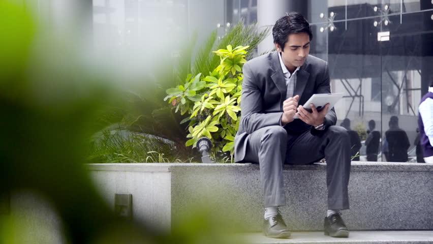 Shot of a businessman using a digital tablet | Shutterstock HD Video #4330100