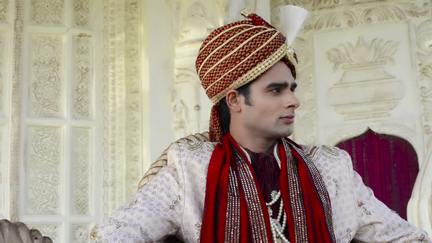 Pan Shot Of A Indian Groom Posing In Traditional Wedding Dress Stock ...