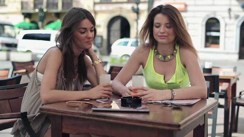 Happy pretty women raising toast to camera in cafe  | Shutterstock HD Video #4364519
