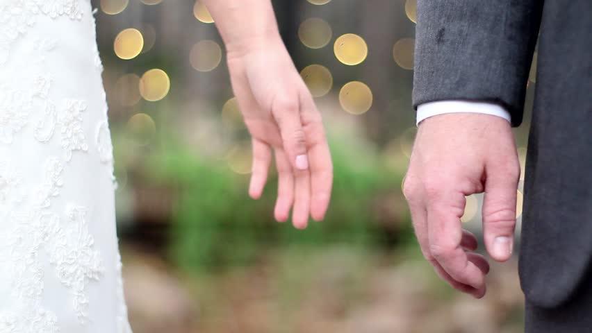 Wedding hand hold bokeh shot
