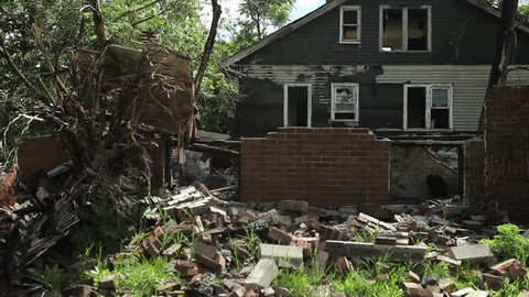 Slider shot of destroyed burned out house in inner city of Detroit. Abandoned Blight House Ghetto Burnout Ruin Bankruptcy Fire War Aftermath Violence Arson Investigation Firefighter