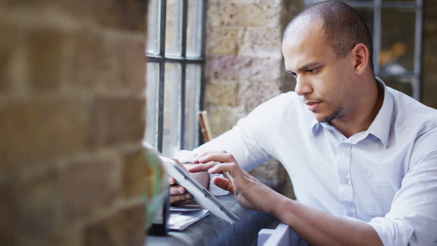 Attractive young man with digital tablet in soft natural light | Shutterstock HD Video #4395494