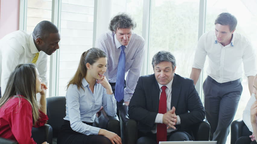 Casual and informal business meeting, colleagues sit together and share ideas | Shutterstock HD Video #4403030