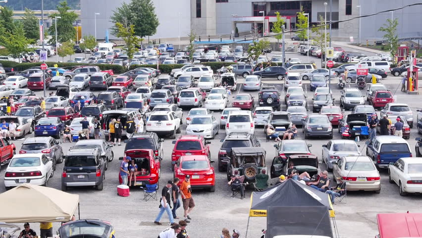 Cars Stands In Traffic Jam And People Walk Along The Footpath