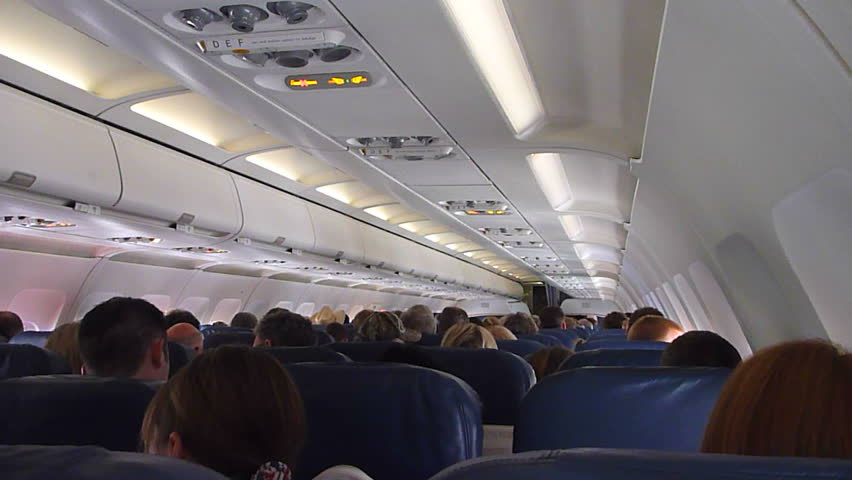 US AIRWAYS INTERIOR FLIGHT - CIRCA 2013: Flying in airplane, point of view as passenger from coach seats.