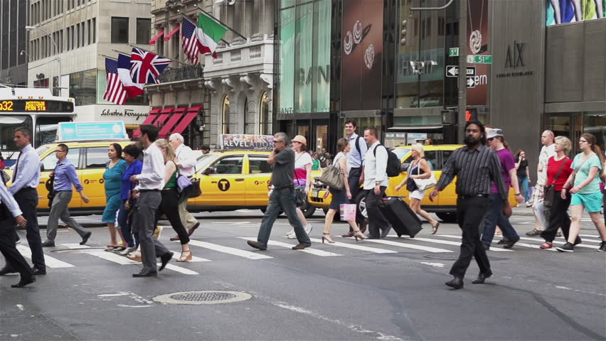 NEW YORK, NY - JULY 8: NYC pedestrians crossing street in slow motion on July 8, 2013 in New York, New York.