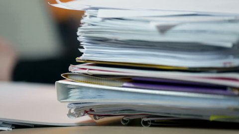 Close up on documents in office