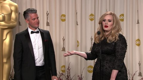HOLLYWOOD - February 24, 2013: Paul Epworth and Adele at the Academy Awards 2013 Press Room and Governors Ball in the Dolby Theatre in Hollywood February 24, 2013