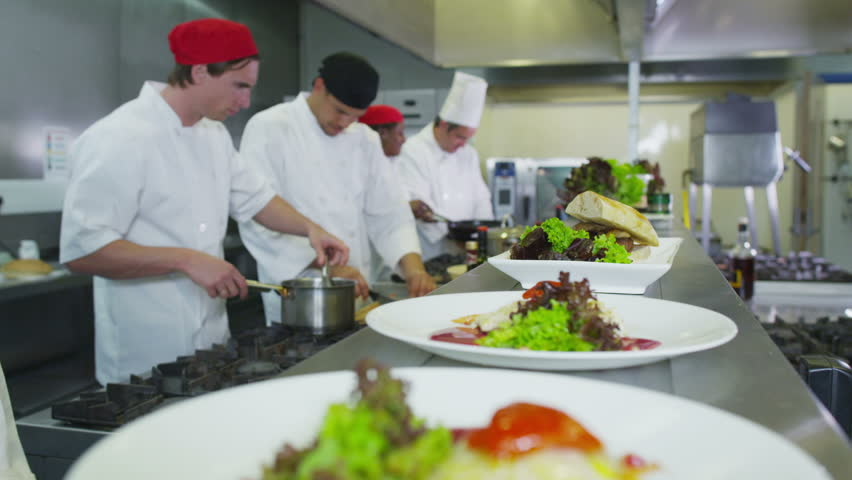 Restaurant Kitchen Video professional chefs in a restaurant or hotel kitchen. they are