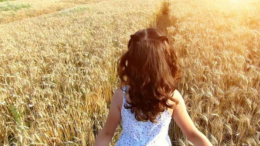 Little girl running cross the wheat field at sunset.Slow motion,high speed camera #4486982