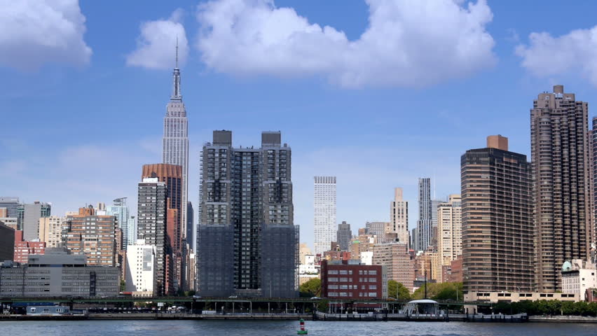 A group of buildings in front of the iconic Empire State Building on Manhattan's