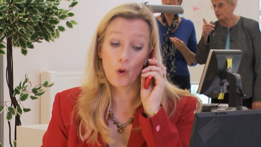 Strong and confident businesswoman struggles to keep her cool on a phone call with a difficult client. High quality HD video footage