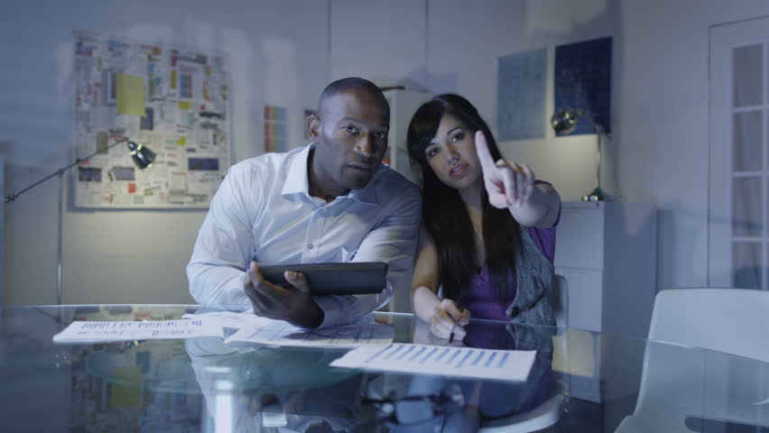 Business team working on futuristic touch screen with tablet remote interface. | Shutterstock HD Video #4496882