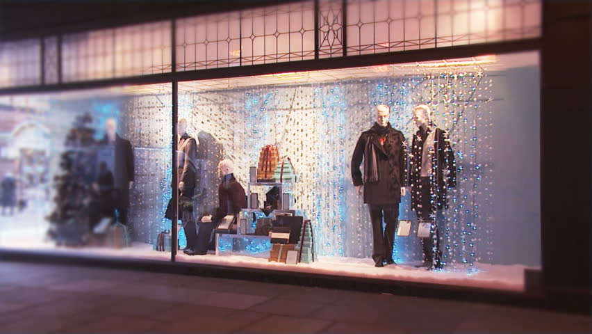 Pretty store front window display with twinkling lights at Christmas. High quality HD video footage