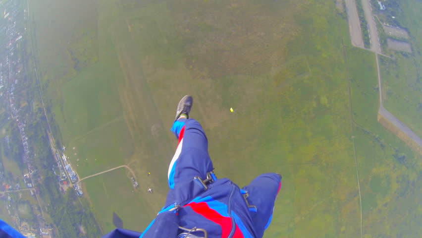 Parachutist against the clear sky video parachute jumps (skydiving) from a first-person  | Shutterstock HD Video #4515857
