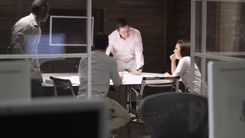 Contemporary small creative business working late through the night.  Casual young people in architecture company. | Shutterstock HD Video #4521797