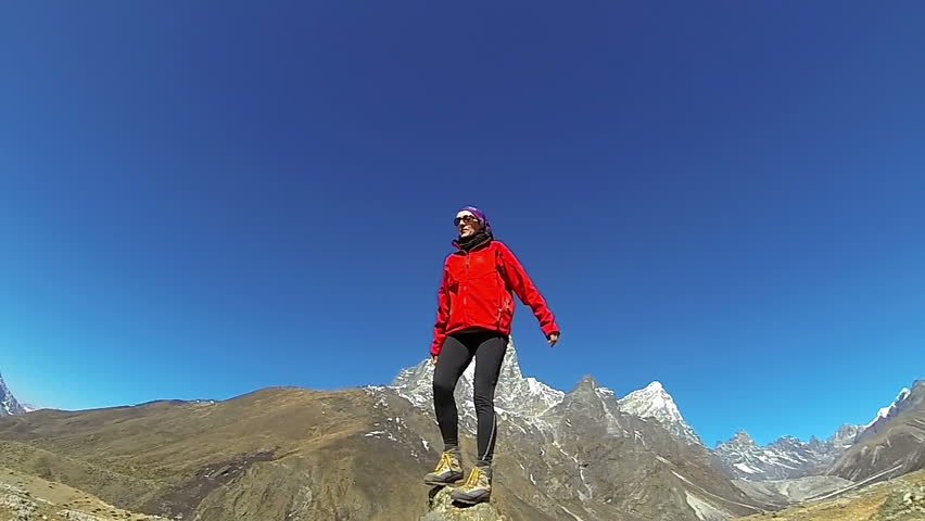 Female mountaineer on the top of world, Mount Everest,Himalayas