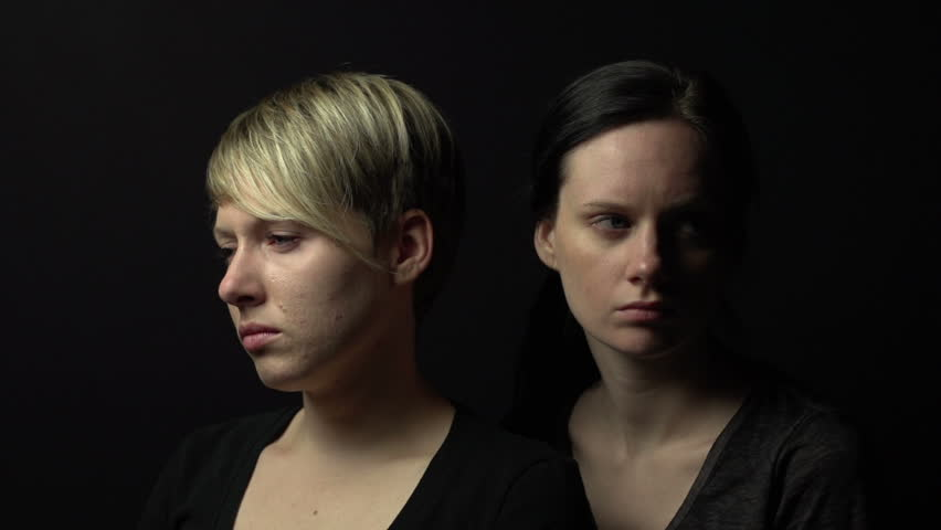 Video portrait of two females, sad, moving light