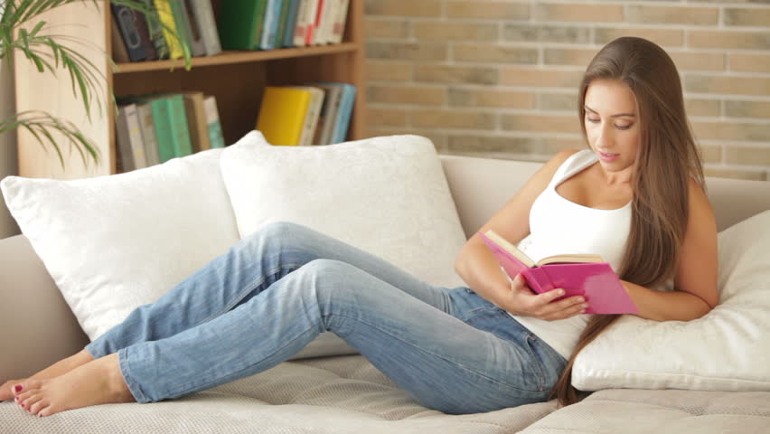 ef12733cfa5a Pretty Girl Relaxing On Sofa Stock Footage Video (100% Royalty-free ...