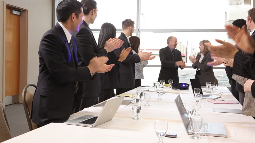 Group of businesspeople clapping | Shutterstock HD Video #4556810