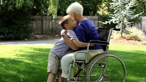 Senior woman in wheelchair gets hugs
