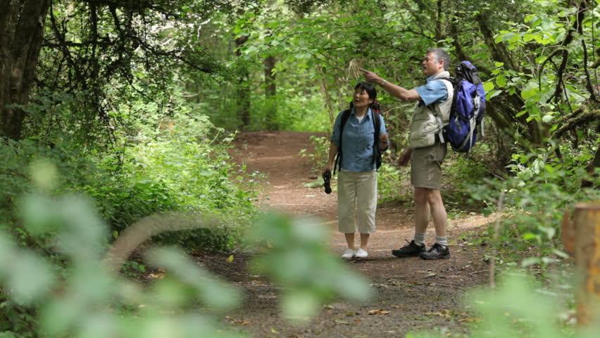 Mature Asian walking on nature trail