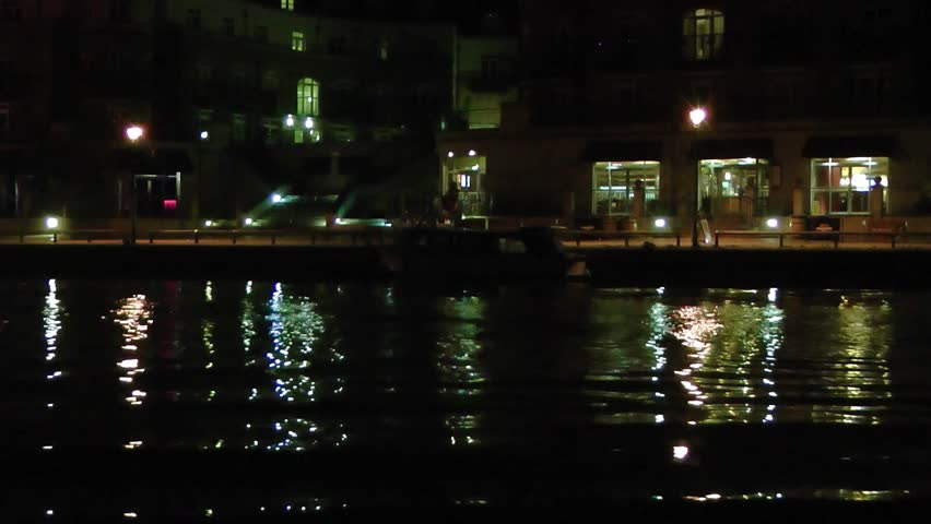 Still Water and Cityscape at Night