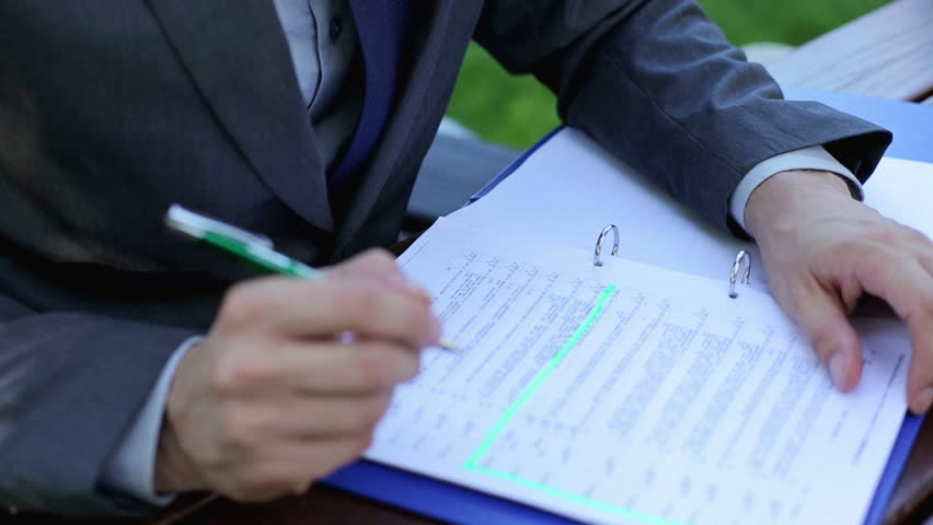 Businessman writing notes in documents  | Shutterstock HD Video #4576742