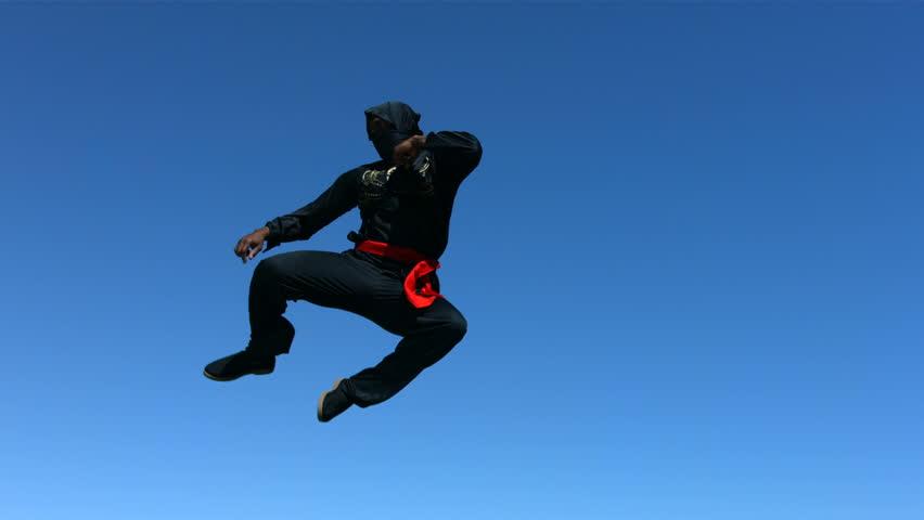 Ninja jumps in air, slow motion