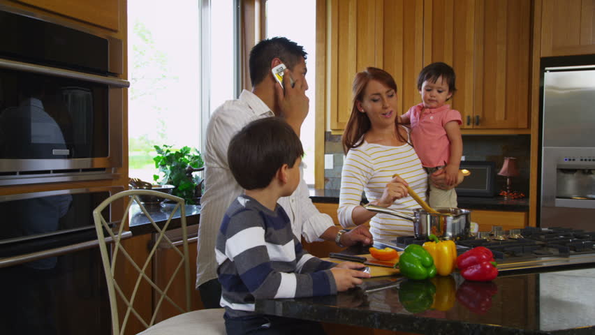 Family in kitchen together, dolly movement