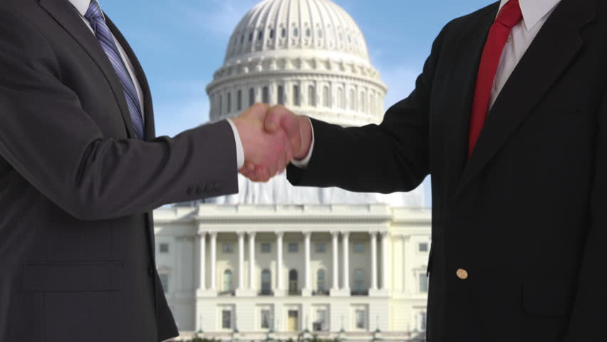 Politicians shaking hands in front of US Capitol