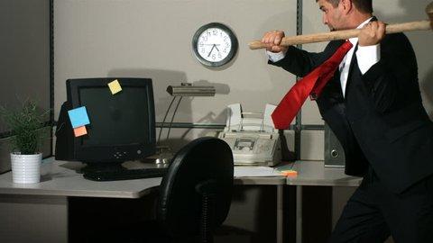Businessman smashing computer, slow motion