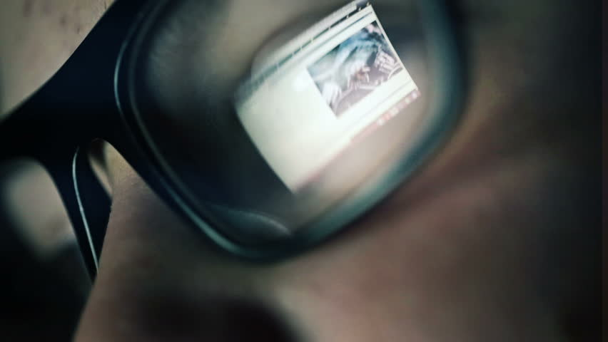 Closeup shot of boy in glasses surfing internet at night  | Shutterstock HD Video #4615517