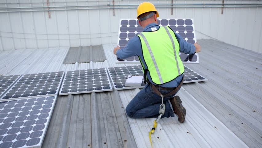 Contractor installing solar panels on rooftop | Shutterstock HD Video #4619924