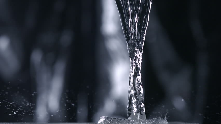 Pouring water on black background shooting with high speed camera, phantom flex.