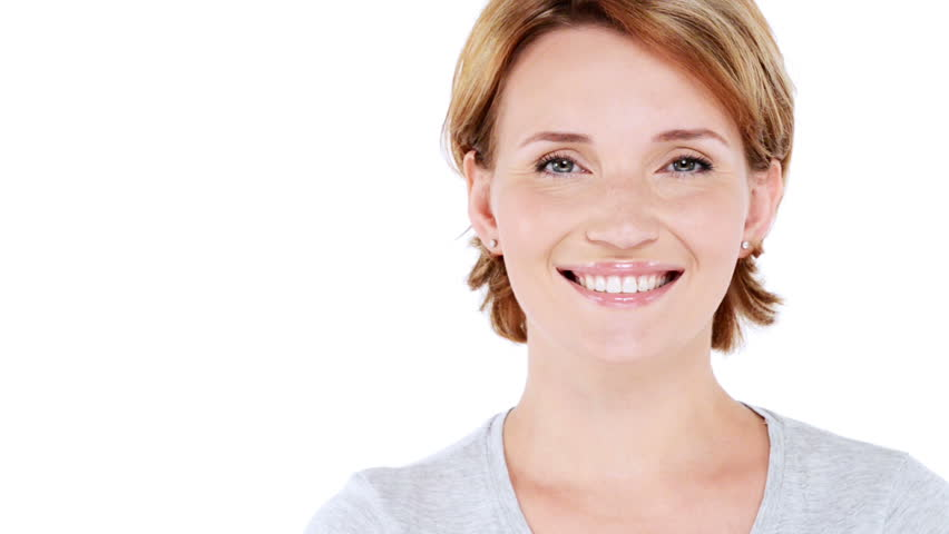 Front  portrait of the beautiful  smiling woman looking at camera over white background. Full hd video clip 1920x1080 | Shutterstock HD Video #4634063