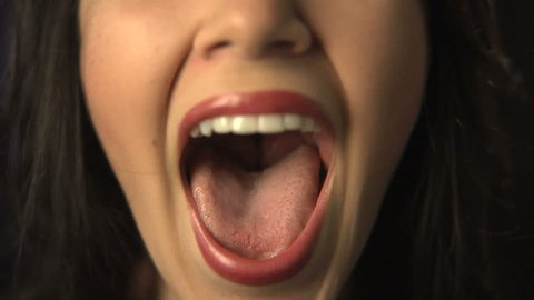 Close up of woman shouting or singing
