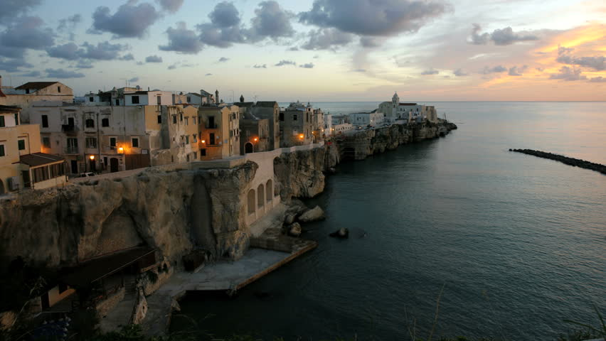 Time lapse at sunrise of Vieste town built a rocky promontory into the Adriatic Sea in Italy
