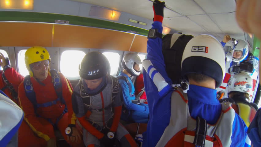 Parachutists exit from the aircraft (shooting from inside) video parachute jumps (skydiving) from a first-person | Shutterstock HD Video #4640531