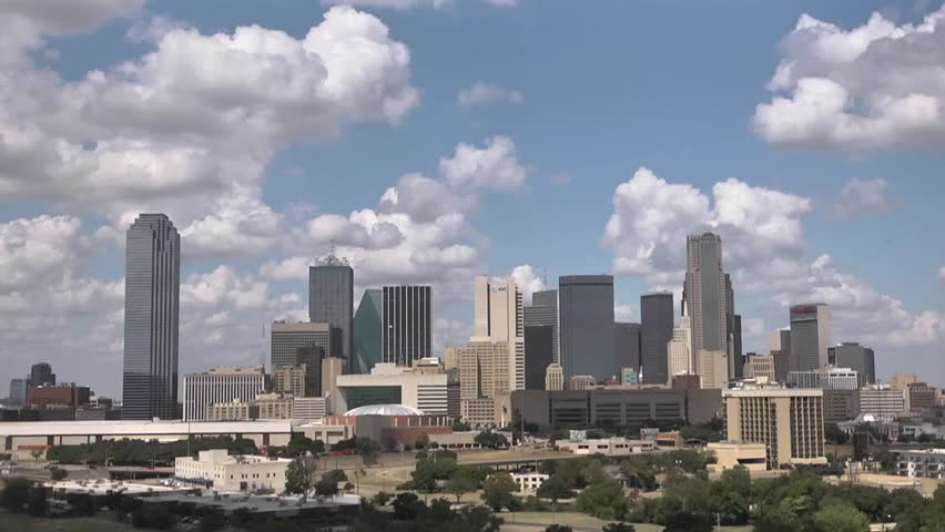time lapse of dallas skyline with fast moving clouds