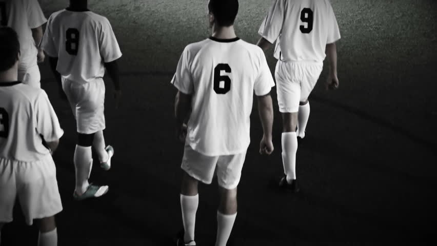 Soccer players march onto the pitch and get ready to start the game | Shutterstock Video #4650068