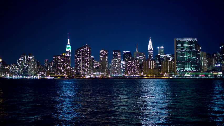 NEW YORK - SEPTEMBER 9, 2013: Manhattan Skyline on beautiful night with Empire State Building and East River in NYC, New York, USA. Manhattan is smallest New York City borough; most densely populated.